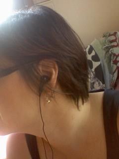 Sansa-slot-radio-earbuds
