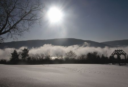 FLX_Canandaigua_winter_mist_over_lake_sunshine_horz