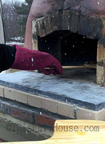 Eagle Crest stone pizza oven in the snow