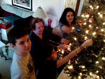 Helping grandma trim her Christmas tree 2011