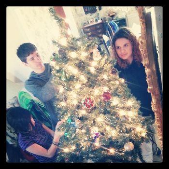 Helping grandma trim her Christmas tree 2013